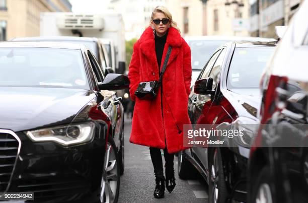 Caro Daur wearing a Mango coat Off White bag and Ash shoes during the Paris Fashion Week on September 29 2017 in Paris