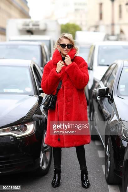 Caro Daur wearing a Mango coat Off White bag and Ash shoes during the Paris Fashion Week on September 29 2017 in Paris