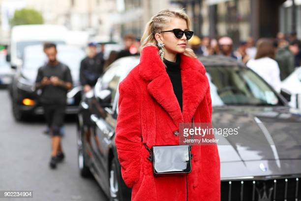 Caro Daur wearing a Mango coat Off White bag during the Paris Fashion Week on September 29 2017 in Paris