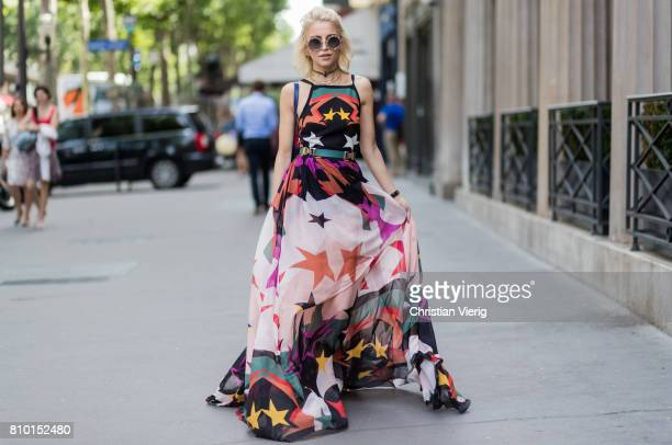 Caro Daur wearing a maxi dress with print outside Elie Saab during Paris Fashion Week Haute Couture Fall/Winter 20172018 Day Four on July 5 2017 in...