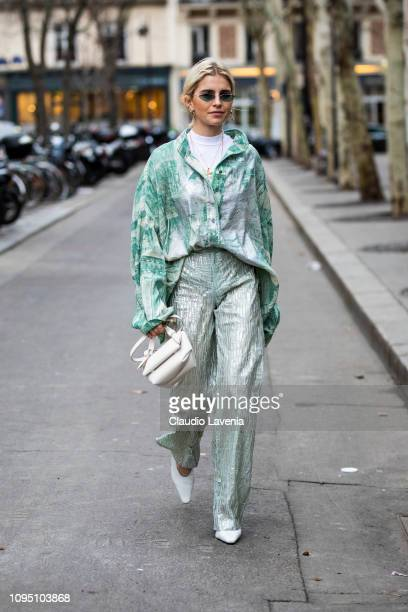 Caro Daur wearing a mint green printed shirt mint green pants white shoes and white bag is seen in the streets of Paris before the Acne Studio show...