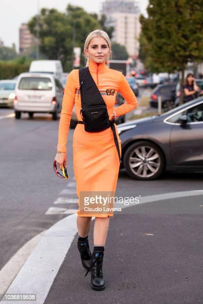 Caro Daur wearing a orange dress is seen in the streets of Milano after the Prada show during Milan Fashion Week Spring/Summer 2019 on September 20...