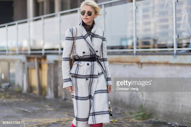 Caro Daur wearing a plaid coat By Malene Birger Dolce Gabbana bag red boots outside By Malene Birger on August 09 2017 in Copenhagen Denmark