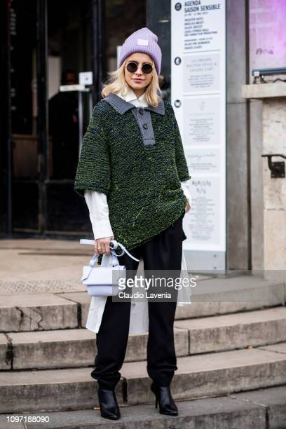 Caro Daur wearing a white shirt green jumper black pants black heels lilac hat and lilac Acne bag is seen in the streets of Paris before the Acne...