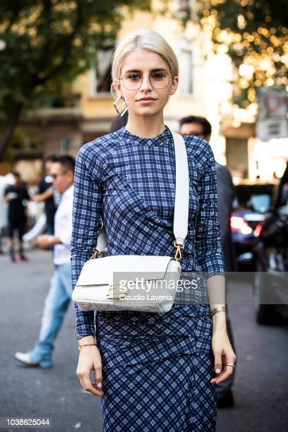 Caro Daur wearing checked dress and Fendi white bag is seen before the Giorgio Armani show during Milan Fashion Week Spring/Summer 2019 on September...