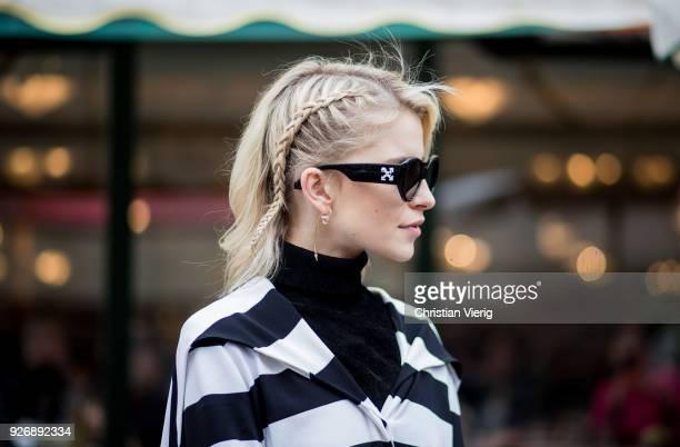 Caro Daur wearing striped coat is seen outside Altuzarra during Paris Fashion Week Womenswear Fall/Winter 2018/2019 on March 3 2018 in Paris France