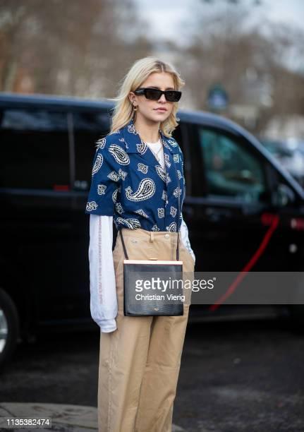Caroine Caro Daur is seen wearing beige pants button shirt outside Lacoste during Paris Fashion Week Womenswear Fall/Winter 2019/2020 on March 05...
