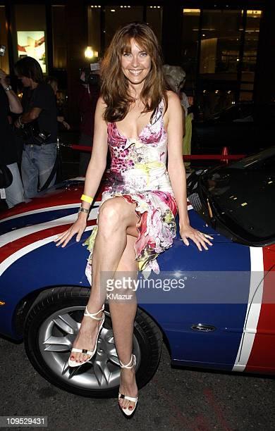 Carol Alt leaning on Austin Powers's XK8 Union Jack Jaguar convertible