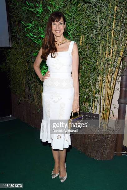 Carol Alt poses at the Andrea Bocelli Celebrity Fight Night 2019 on July 28 2019 in Forte dei Marmi Italy