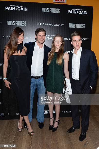 Carol Alt poses with guests at the Cinema Society screening of Pain And Gain at Crosby Street Hotel on April 15 2013 in New York City