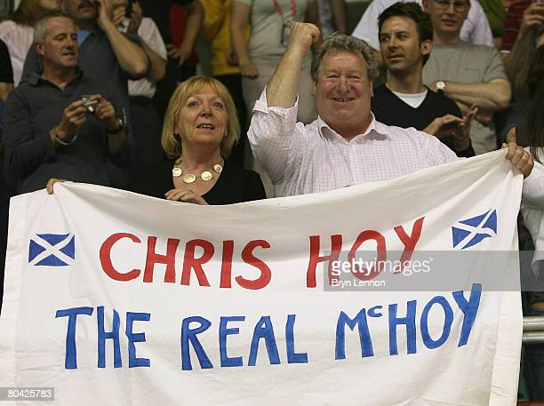 Carol and David Hoy show off a banner supporting their son Chris following his victory in the Men's Keirin Final during the UCI Track Cycling World...