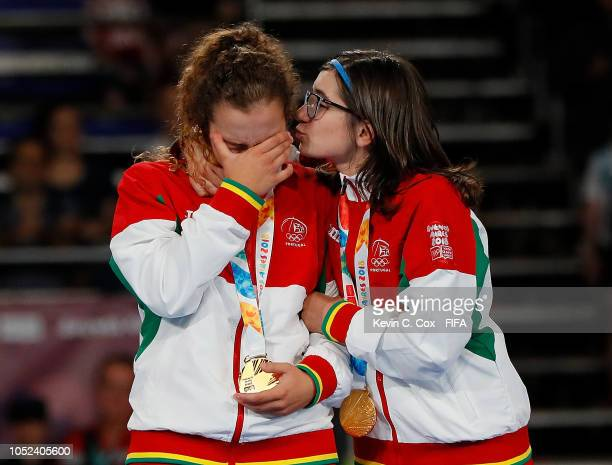 Carol and Martinha of Portugal celebrate after their 41 win over Japan in the Women's Futsal Final match between Portugal and Japan during the Buenos...