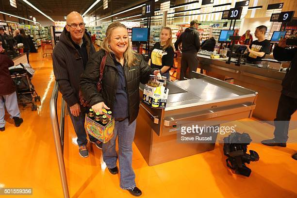 Carol and William Warner are a pair of the first to purchase beer Three lanes at the Leslieville Loblawas are equipped to handle beer sales the lanes...