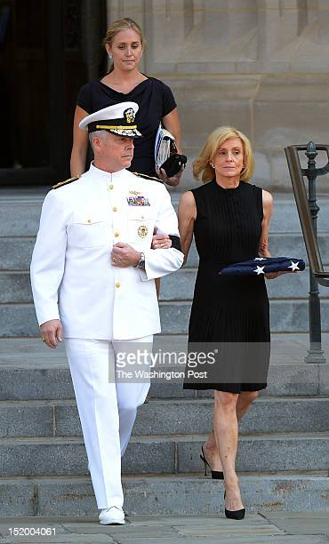 Carol Armstrong is escorted by Admiral Patrick Lorge as she leaves the public memorial service for her husband astronaut Neil Armstrong at the...