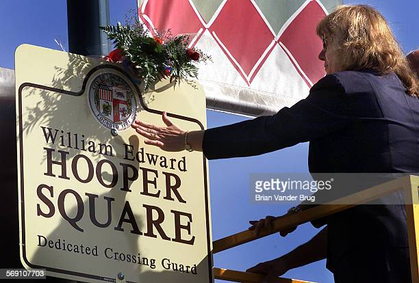 Carol Armstrong right fiance of slain crossing guard William Hooper reaches out to touch memorial plaque at intersection of Bakman Ave and Magnolia...