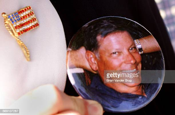 Carol Armstrong wears a button with picture of her slain fiance crossing guard William Hooper during Thursday afternoon memorial dedication in honor...
