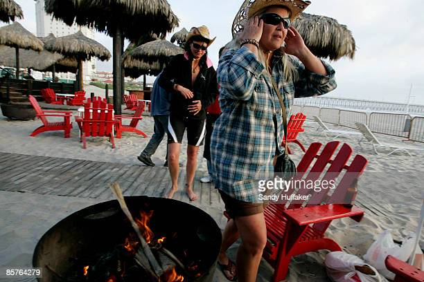 Carol Arthur and Tammy Delu from Seattle relax at a bar along the beach April 1 2009 in Rosarito Mexico The tourist industry in some northern Mexican...