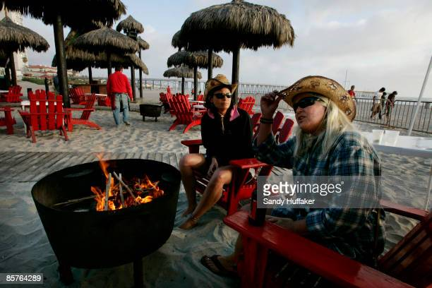 Carol Arthur and Tammy Delu from Seattle sit at a bar along the beach April 1 2009 in Rosarito Mexico The tourist industry in some northern Mexican...