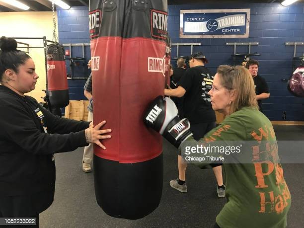 Carol Auer of Batavia Ill who has Parkinson's disease practices her boxing skills at an open house at the Jesse The Law Torres Boxing Club which is...