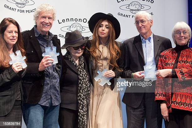 Carol Blue Hitchens US author John Perkins Yoko Ono US singer Lady Gaga Craig and Cindy Corrie parents of peace activist Rachel Corrie pose during...