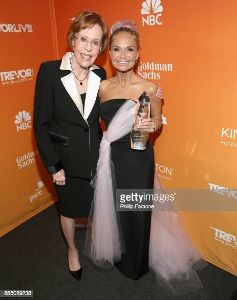 Carol Burnett and Kristin Chenoweth pose with the Icon Award during The Trevor Project's 2017 TrevorLIVE LA Gala at The Beverly Hilton Hotel on...