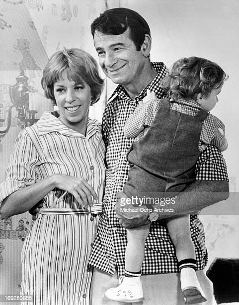 Carol Burnett and Walter Matthau hold their child in a scene from the film 'Pete 'N' Tillie' 1972 Photo by Universal/Getty Images