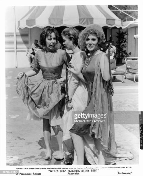 Carol Burnett Elizabeth Montgomery and Jill St John posing in Edith Head costumes in between scenes from the film 'Who's Been Sleeping In My Bed' 1963
