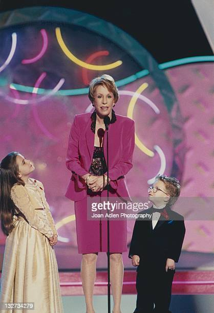 Carol Burnett Mae Whitman and Jonathan Lipnicki at the American Comedy Awards on February 9 1997 at the Shrine Auditorium in Los Angeles California