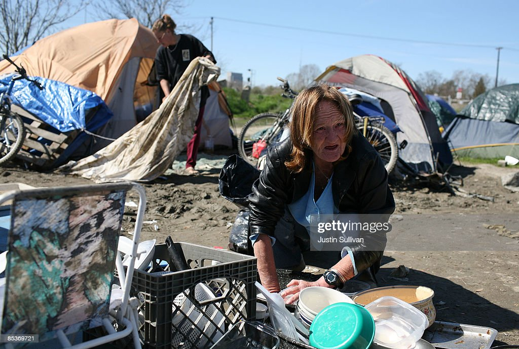 Carol Carlile washes dishes outside her tent March 10 2009 in Sacramento California. & Sacramento Tent City Fills Up Jobless And Homeless Photos and ...