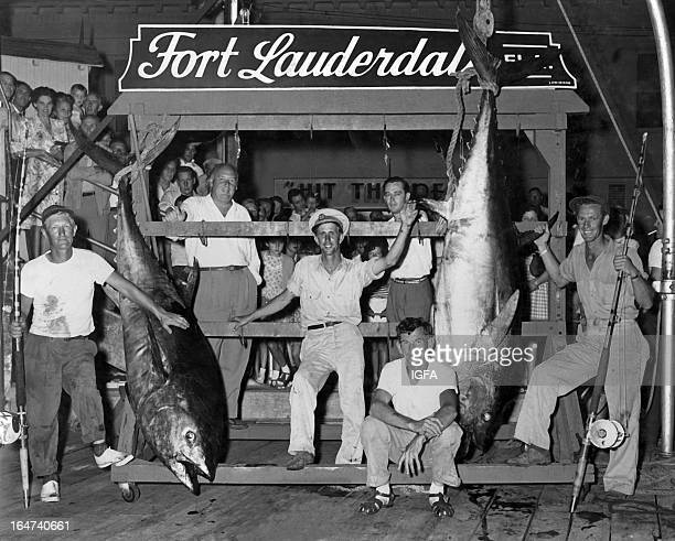 Carol Chance poses with two large tuna caught on the fishing boat Tia Juana near Fort Lauderdale Florida in May of 1947