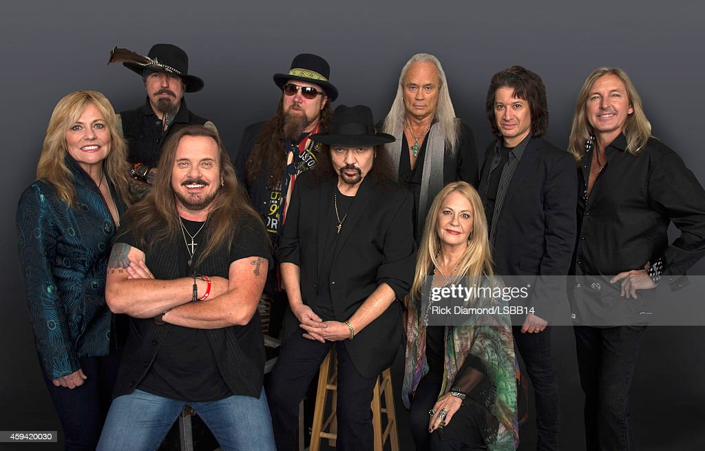 This image has been retouched.) Carol Chase, Johnny Colt, Johnny Van Zant, Peter Keys, Gary Rossington, Rickey Medlocke, Dale Rossington, Michael Cartellone, and Mark 'Sparky' Matejka of Lynyrd Skynyrd pose backstage at One More For The Fans! - Celebrating the Songs & Music of Lynyrd Skynyrd at The Fox Theatre on November 12, 2014 in Atlanta, Georgia.