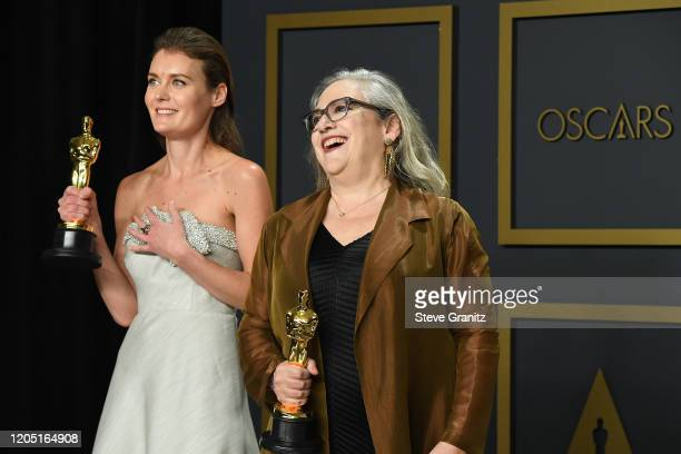 """Carol Dysinger and Elena Andreicheva winners of the Documentary Short Subject award for """"Learning to Skateboard in a Warzone """" poses in the press..."""