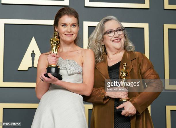 """Carol Dysinger and Elena Andreicheva winners of the Documentary Short Subject award for """"Learning to Skateboard in a Warzone """" pose in the press room..."""