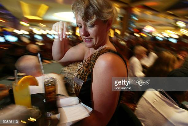 Carol Eleuterio delivers drinks to poker tables May 11 2004 during the grand opening for the Seminole Hard Rock Hotel and Casino in Hollywood Florida...