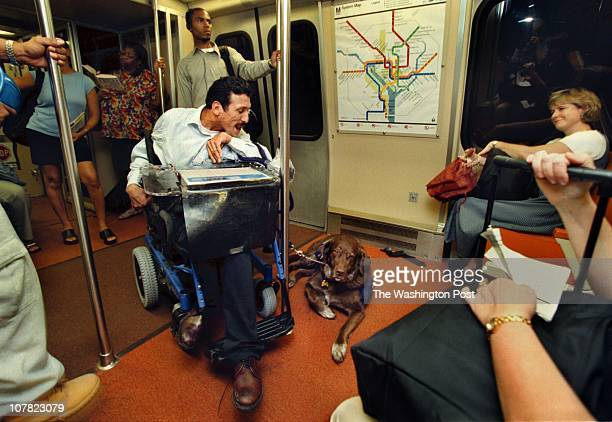 DOGS THAT HEAL Gus Estrella a policy analyst at United Cerebral Palsey in DC takes the metro after work with his assistance dog 'Boz' on his way home...