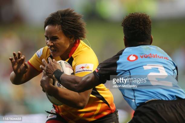 Carol Humeu of PNG is tackled during the Women's Pacific International Test Match between Fijji and Papua New Guinea at Leichhardt Oval on June 22,...