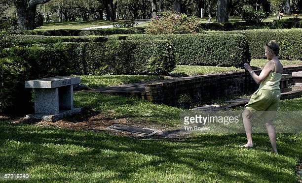 Carol Irons of Greenville North Carolina takes a phototgraph of Terri Schiavo's gravesite at the Sylvan Abbey Memorial Park March 30 2006 in...