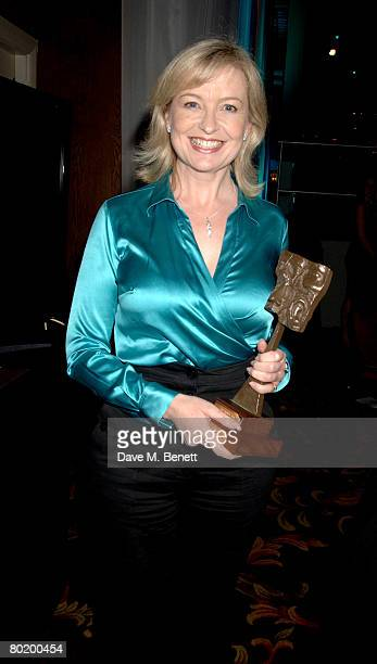Carol Kirkwood poses in the awards room with her Best Weather Presenter Award during the Television And Radio Industries Club Ceremony 2008 at the...