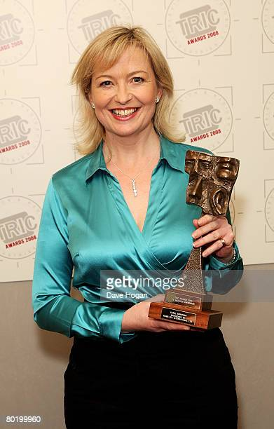 Carol Kirkwood poses in the awards room with the TV Weather Presenter award sponsored by HomeTek International Ltd at the Television And Radio...