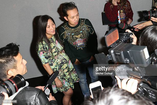 Carol Lim and Humberto Leon of New york boutique 'Opening Ceremony' attend the Kenzo Spring / Summer 2013 show as part of Paris Fashion Week at...