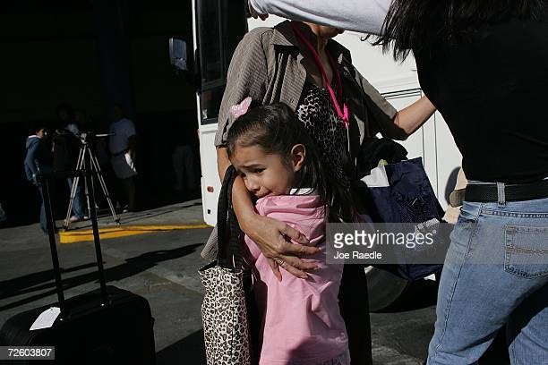 Carol Long is hugged by Taylor Politi after she disembarked from the Carnival Liberty Cruise ship at Port Everglades on November 19 2006 in Fort...