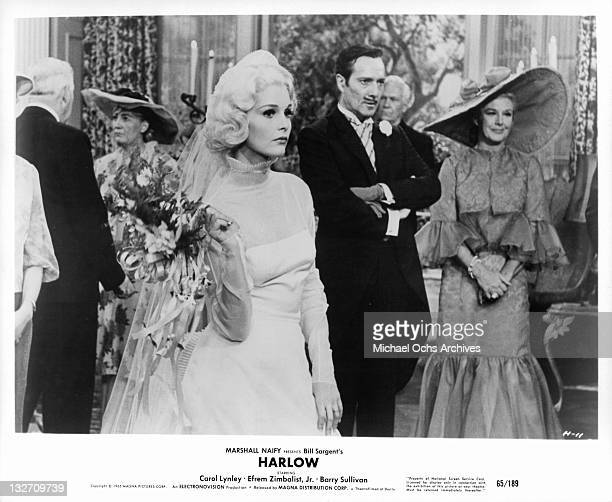 Carol Lynley Barry Sullivan and Ginger Rogers at formal event together in a scene from the film 'Harlow' 1965