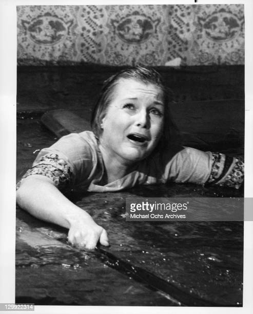 Carol Lynley pleads for help in a scene from the film 'Flood' 1976