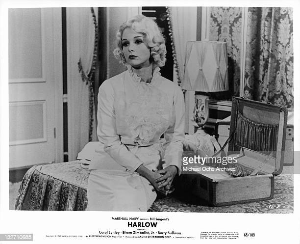 Carol Lynley sitting on bed in a scene from the film 'Harlow' 1965