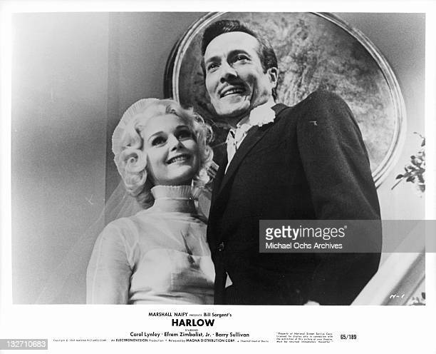 Carol Lynley smiling with Barry Sullivan in a scene from the film 'Harlow' 1965