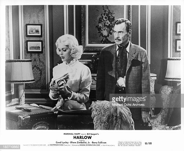 Carol Lynley talks while Barry Sullivan listens in a scene from the film 'Harlow' 1965