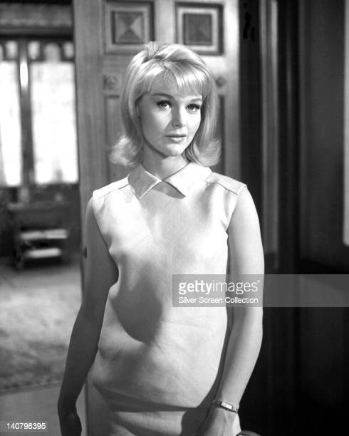Carol Lynley US actress wearing a sleeveless white dress in a studio portrait circa 1965
