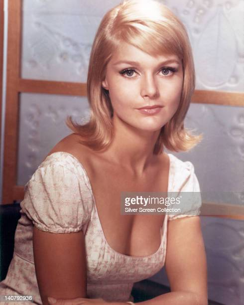 Carol Lynley US actress wearing a white shortsleeve top with a scoop neckline in a studio portrait circa 1970