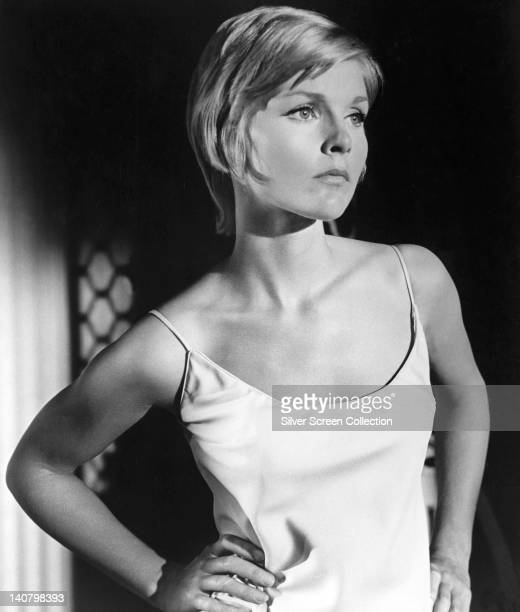 Carol Lynley US actress wearing a white thin strap top posing with her hands on her hips in a studio portrait circa 1965