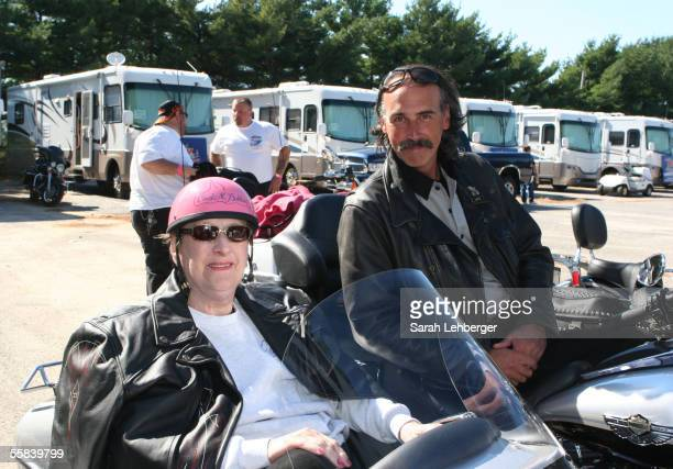 Carol M Baldwin and Rob Schneider arrive by motorcycle to the 2005 Weekend For A Cure festival at the Flowerfield Fairgrounds on October 2 2005 in St...